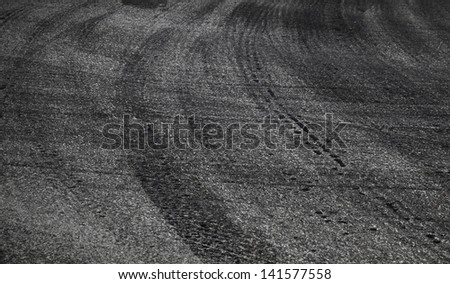 Dangerous turn. Abstract road background with tires tracks on asphalt - stock photo