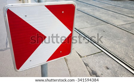 Dangerous turn right, red and white roadsign on urban road side  - stock photo