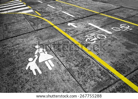 Dangerous walk on city street. Pavement and cycle track marks on city street. - stock photo