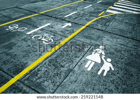 Dangerous walk on city street. Pavement and cycle track marks on city street. Blue color tone used. - stock photo