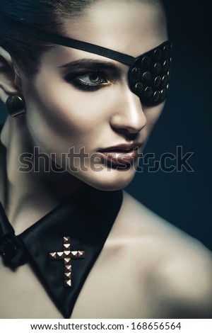 dangerous woman with eye-patch - stock photo