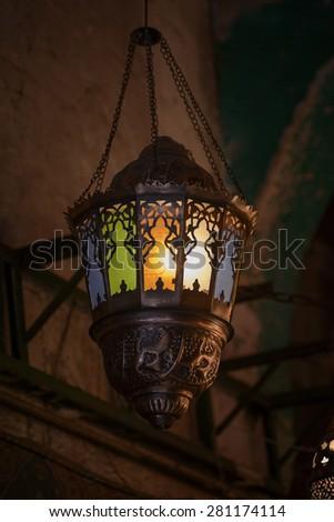 Dangling Decorative Ramadan Festive Lantern Glowing in Dark - stock photo