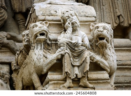 Daniel in the lions' den. Architectural detail. Facade of the church of St. Trophime in Arles. (Provence, France) - stock photo