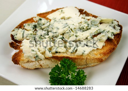 Danish blue cheese spread on to a crisp slice of toast.