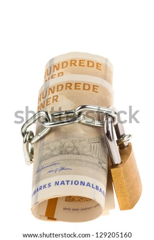 danish crowns. currency from denmark in europe and a lock. safe investment of money. - stock photo