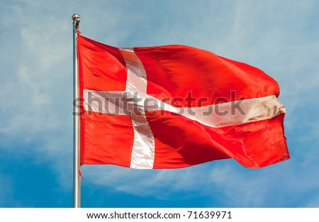 danish flag on a pole over beautiful sky - stock photo