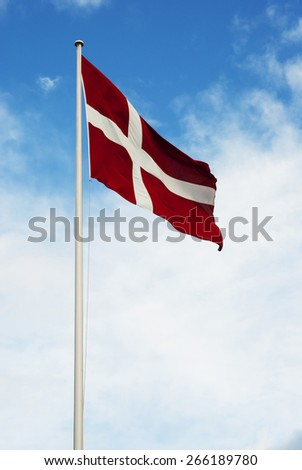 Danish flag waving in the wind - stock photo