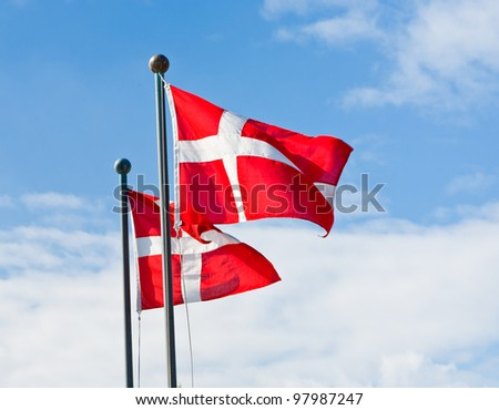 danish flags with blue sky on background