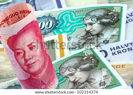 danish kroner. currency of denmark in europe. and chinese yuan - stock photo