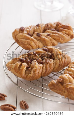 Danish pastry maple pecan with nuts and maple syrup - stock photo