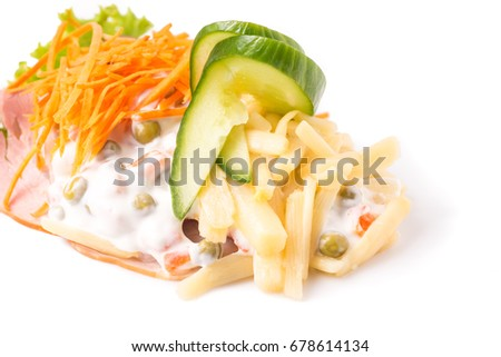 Danish specialties and national dishes, high-quality open sandwich. Sandwich with sliced ham, Mayonnaise with green peas and carrot tart, cracked carrots, asparagus and cucumbers