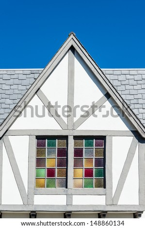Danish style architecture in Solvang, California - details with stained glass window - stock photo