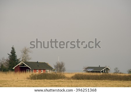 Danish summerhouses in winter nature  - stock photo
