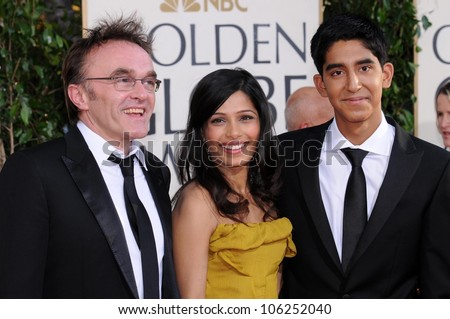 Danny Boyle with Freida Pinto and Dev Patel at the 66th Annual Golden Globe Awards. Beverly Hilton Hotel, Beverly Hills, CA. 01-11-09 - stock photo