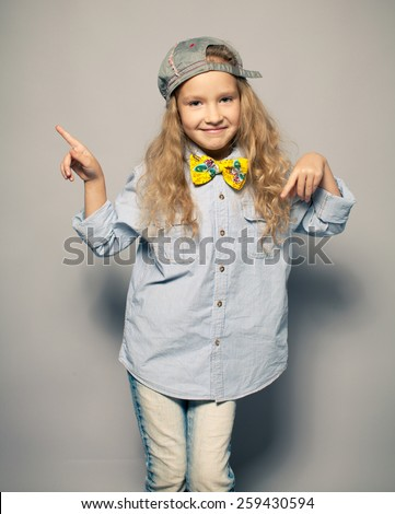 Dansing child. Motions fashion girl studio shot - stock photo
