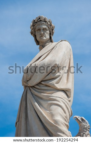 Dante Alighieri's statue in Florence in blue sky - stock photo