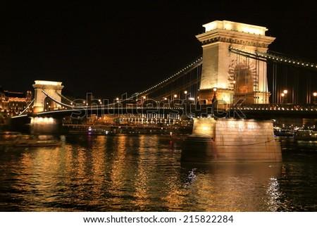 Danube river and the Chain bridge illuminated by night, Budapest, Hungary - stock photo