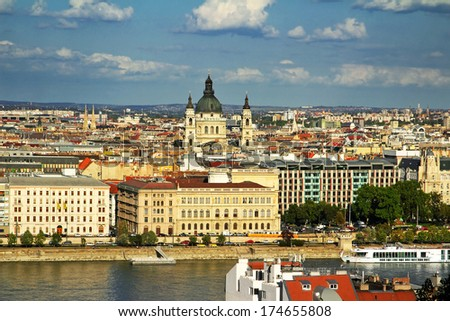 Danube River embankment and St. Stephen's Basilica. Basilica is the largest church in Budapest. Danube River embankment in Budapest is World Heritage Site by UNESCO - stock photo