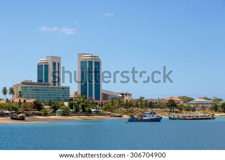Dar Es Salaam blue beach with buildings in the background, Tanzania, Africa - stock photo