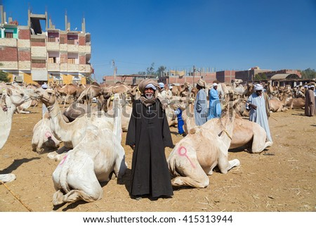 DARAW, EGYPT - FEBRUARY 6, 2016: Local camel salesman on Camel market. - stock photo