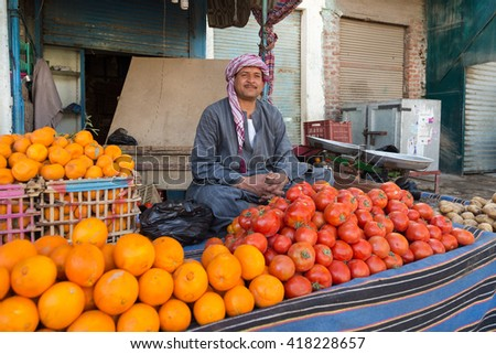 DARAW, EGYPT - FEBRUARY 6, 2016: Local food vendor at Daraw market selling oranges and tomatoes.