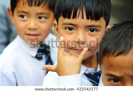 DARJEELING, INDIA - APRIL 15: Unidentified boy shows hand with love sign during entry to the zoo on April 15, 2016 in Darjeeling, India. Children have field visit to Padmaja Naidu Himalayan Zoology.