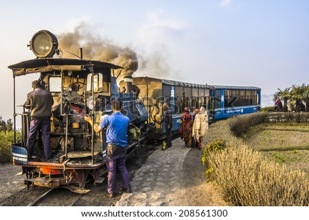 DARJEELING, INDIA - MARCH 11, 2014: The historic narrow gauge train of darjeeling at a stop on the route. - stock photo