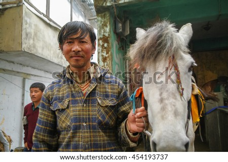 Darjeeling, India - May 3, 2011: An unidentified Indian man of Horse rentals, the owner of a Horse rentals in Darjeeling