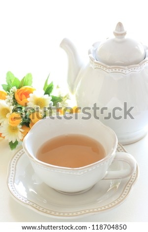 Darjeeling tea and scone for Afternoon tea image - stock photo