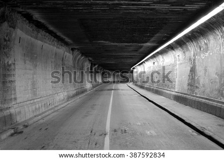 dark abandoned tunnel - stock photo