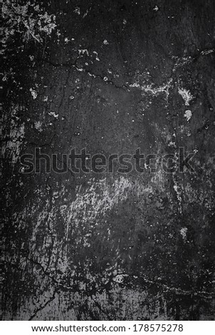 Dark adobe wall texture, great for grunge backgrounds. - stock photo