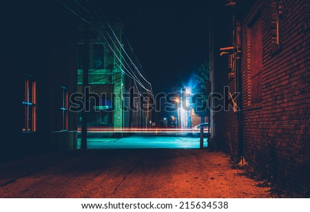 Dark alley and light trails in Hanover, Pennsylvania at night. - stock photo