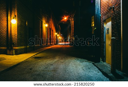 Dark alley at night in Hanover, Pennsylvania. - stock photo