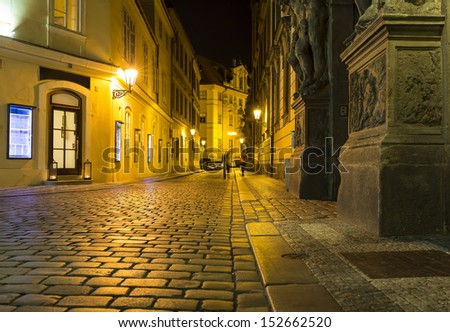 Dark alley in Prague, Czech Republic - stock photo