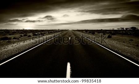 Dark and gloomy road - stock photo