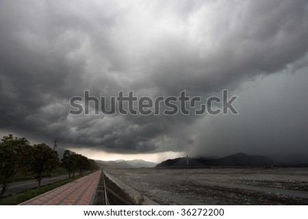 Dark and heavy cloud appears on mountain.