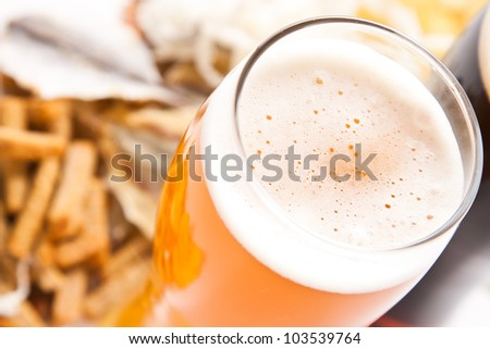 dark and light beer with any snack - stock photo