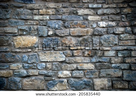 Dark and old stone wall  - stock photo