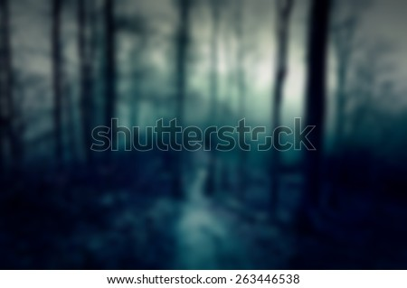 Dark and scary blurred background with forest: for web usage - stock photo
