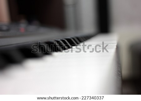 dark and white keys of a piano as background music