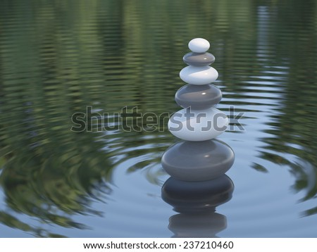 Dark and white Zen stones in a lake symbol for calmness harmony and spirituality - stock photo