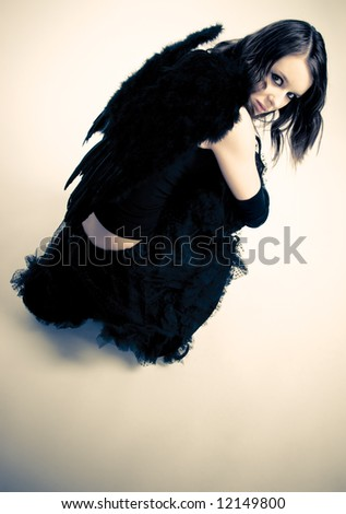 Dark angel. Yellow and black contrast colors. - stock photo