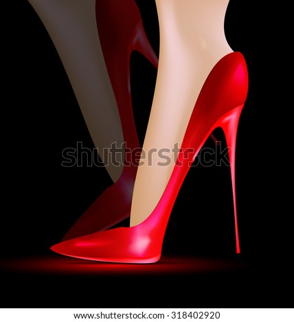 dark background and feet in a red ladys shoe - stock photo