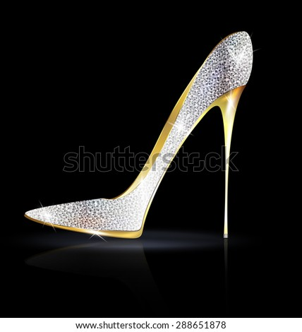 dark background and the silver golden ladys shoe-spiky - stock photo