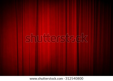 Dark background:closed red theater curtain. Image with selective focus - stock photo