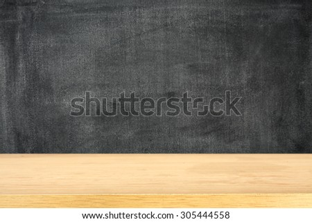 dark background of black board and yellow desk top  - stock photo