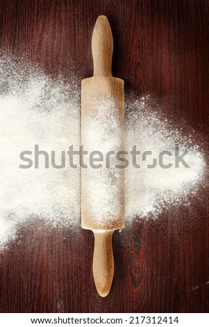 dark background of wood in red and white flour with pin  - stock photo