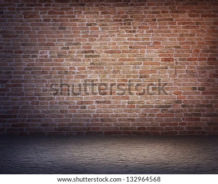 Dark background with an old red brick wall - stock photo