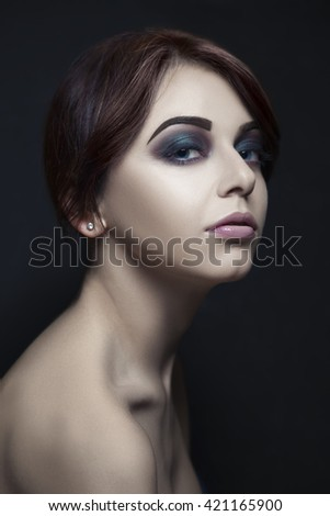 Dark beauty portrait makeup of an attractive young woman.