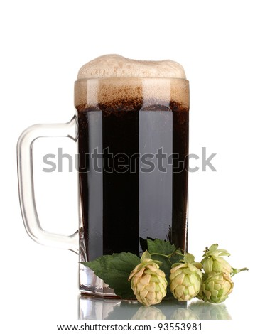 dark beer in a mug and green hop isolated on white - stock photo